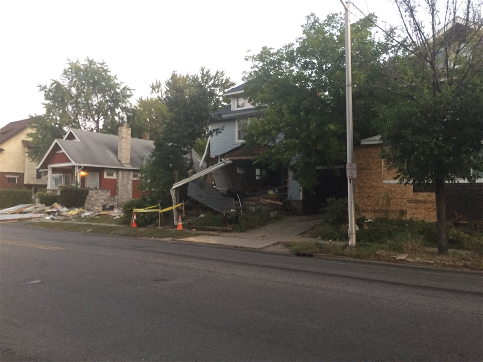 The three homes damaged when a pickup crashed into them.