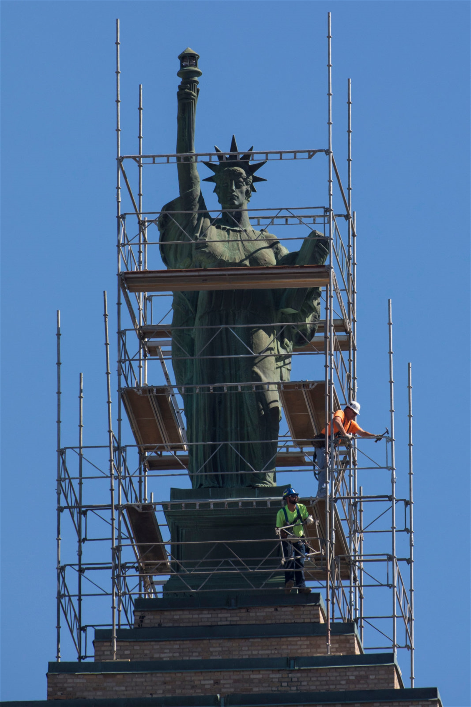 Workers install scaffolding around Lady Liberty atop the Liberty Building, Monday, Oct. 2, 2017.