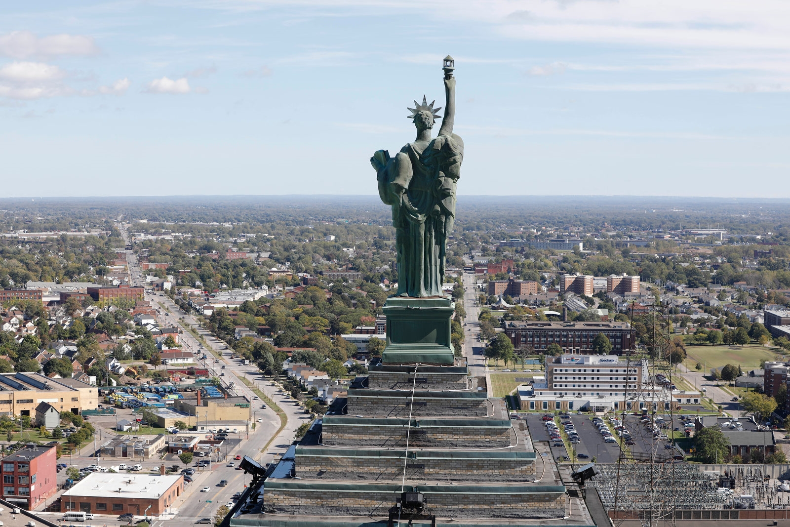 The view of Lady Liberty atop the eastern tower as seen from the western tower.