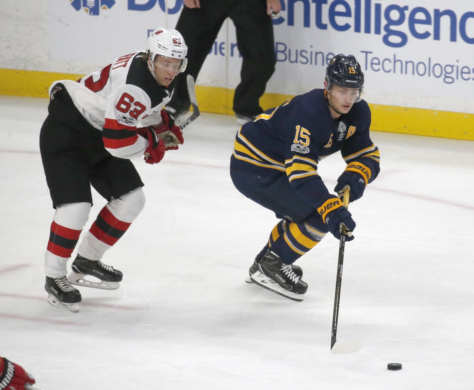 Buffalo's Jack Eichel (15) beats New Jersey's Jesper Bratt (63) to the puck in first-period action.