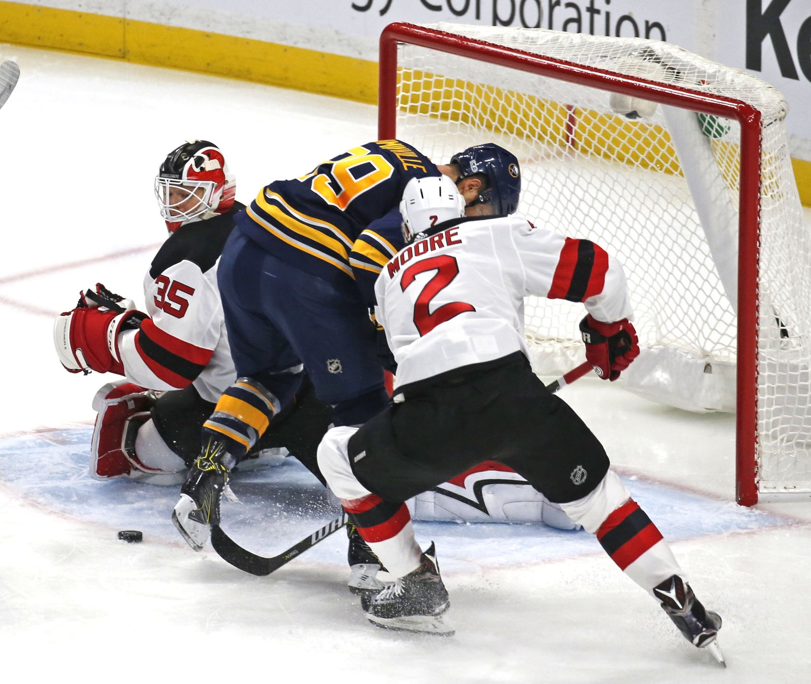 Buffalo's Jason Pominville (29) finds himself in a missed oppurtunity near the N.J. net as NJ's John Moore (2) clears the puck out from under him.