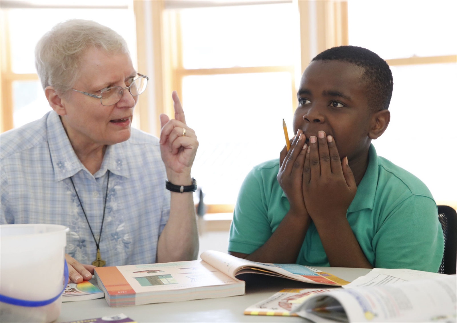 The St. Mary Center, a retirement home for a group of nuns, now hosts the Somali Bantu Afterschool Program on the West side.  The students, K-8th grade, each have a tutor to help them with their homework.  Sister Corinne Yarborough helps Humadi Somo, 14, with his reading, Thursday, Sept. 14, 2017.  He's in 8th grade.