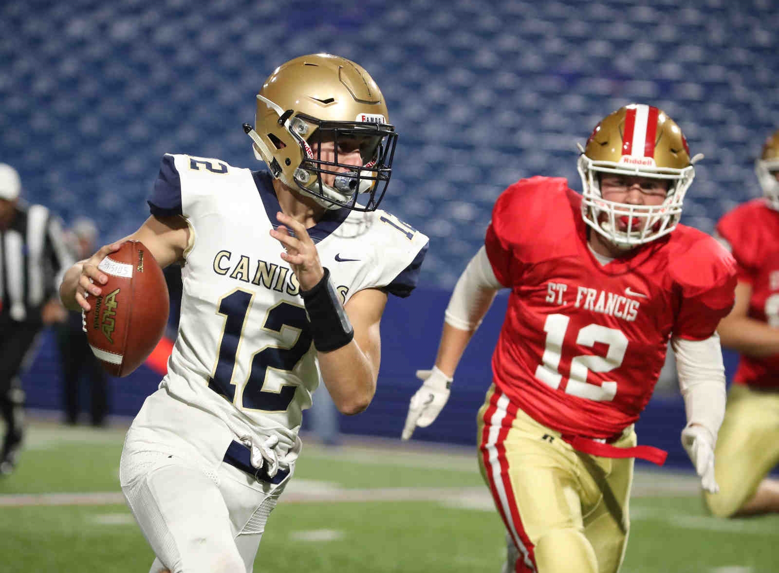 Canisius Jack Westermeier beats St. Francis Jordan Schindler for the two point conversion in the first quarter.
