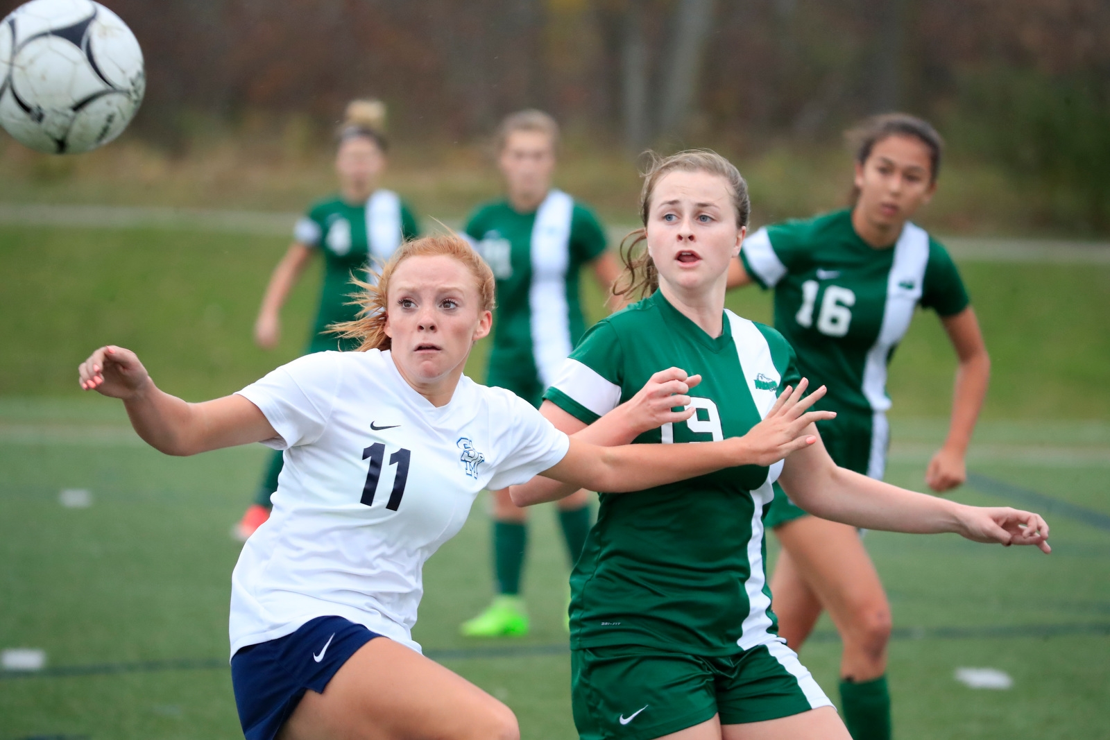 St. Mary's Skylr Baun and Nardin's Shannon Clough battle for a loose ball during first half action.