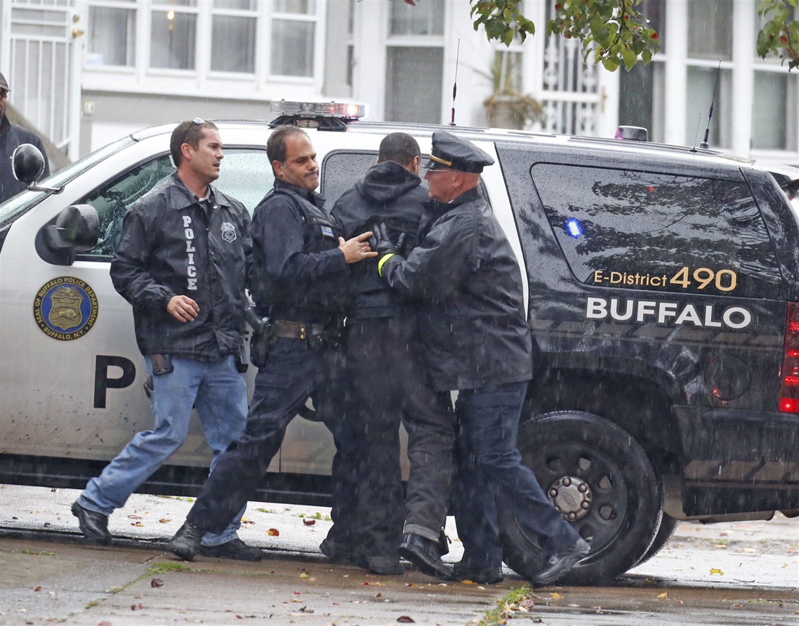 Buffalo police restrain a distressed family member.