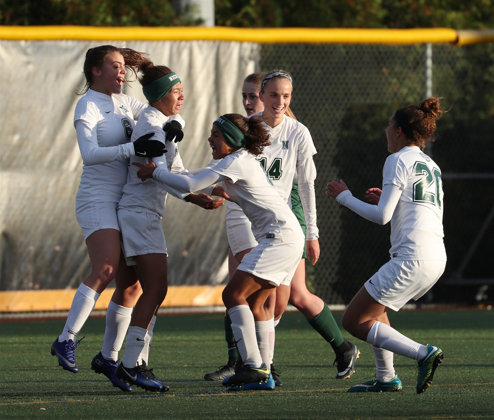 Nichols celebrates as Marisa Warren (second from left) scores the first goal of the game.