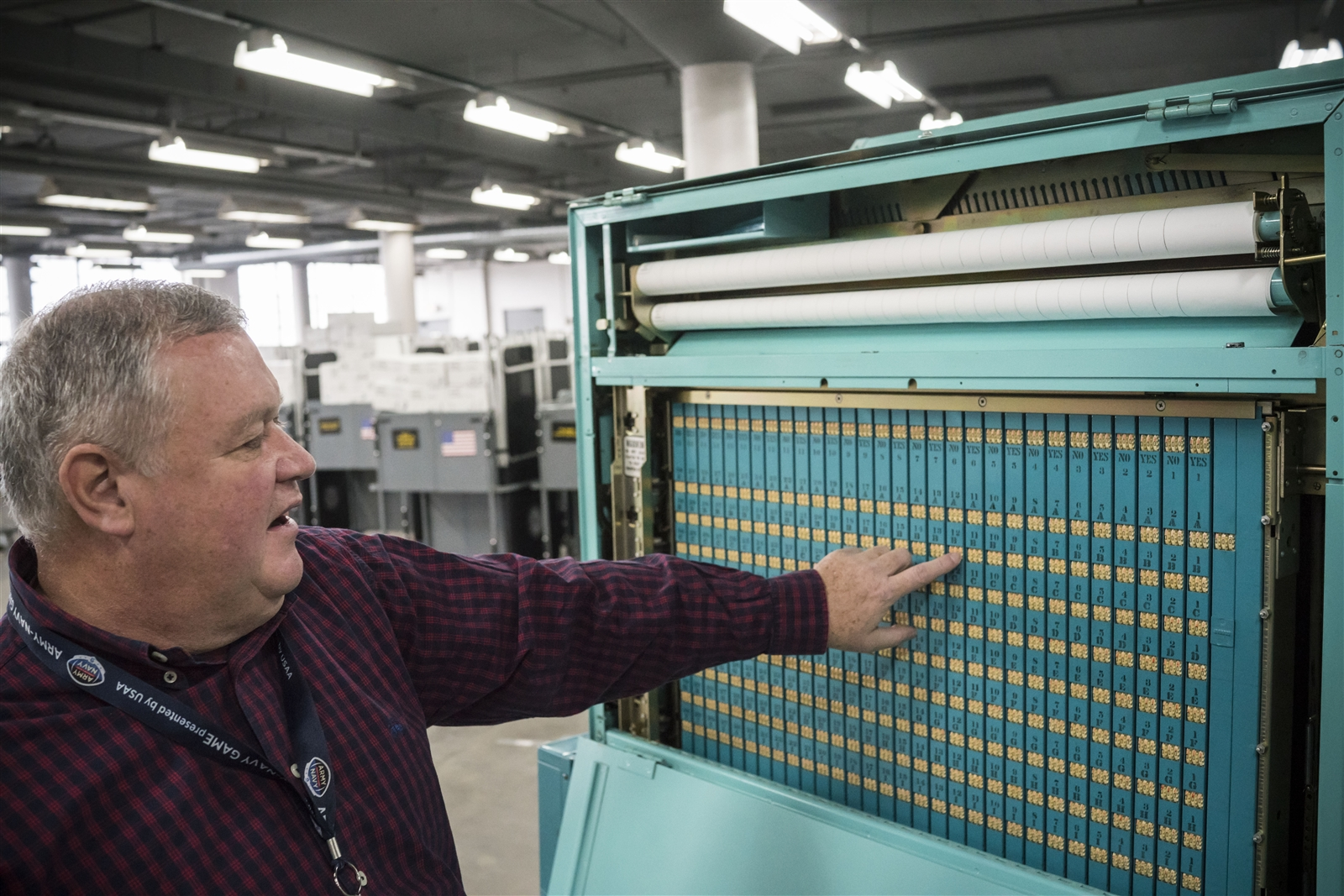 Erie County Election Commissioner Ralph Mohr explains the counters on the inside of on an old-style voting machine that was used until the county switched to electronic machines in the Erie County Board of Elections warehouse at the Tri-Main Building, Wednesday, Nov. 1, 2017.