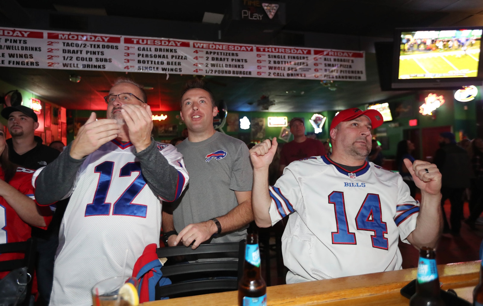Brian Willison of the Town of Tonawanda, Dan Scott of Buffalo, and Steve Marchiano of the Town of Tonawanda, really get into the game.