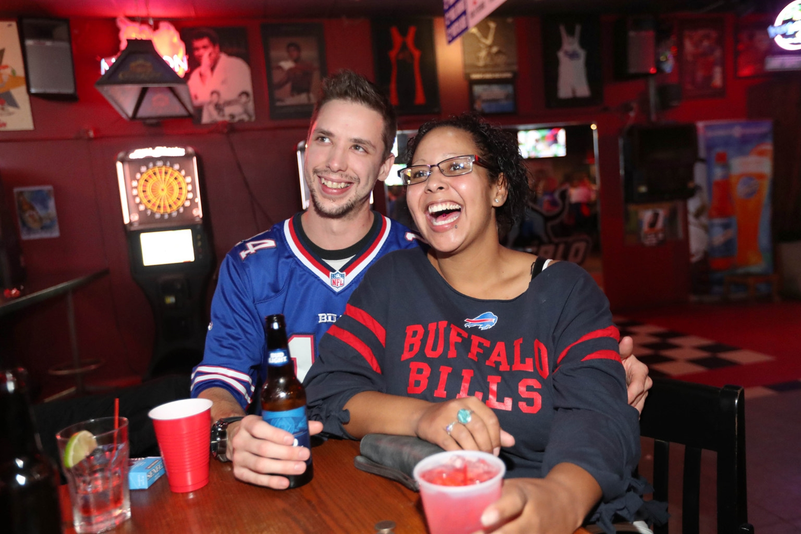 Stephen Gillis of North Tonawanda and Sasha Botting of Lockport watch the game.