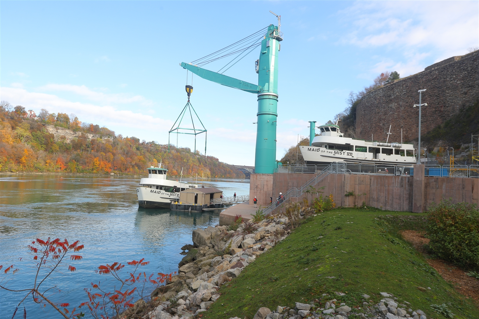 Maid of the Mist VII and VI are lifted out of the water and put in dry dock along the lower Niagara River in Niagara Falls on Wednesday, Nov. 8, 2017.