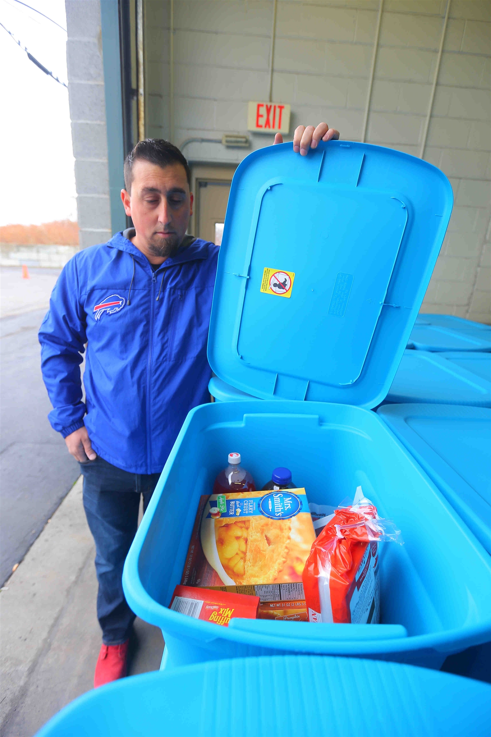 Steve Cutlip of the Buffalo Bills organization with some of the bins of food to be distributed by Bills players and personnel distributed Thanksgiving meals to families at the Food Bank Bank of WNY, in Buffalo on Tuesday, Nov. 14, 2017, as part of the annual Thanksgiving Blitz event.