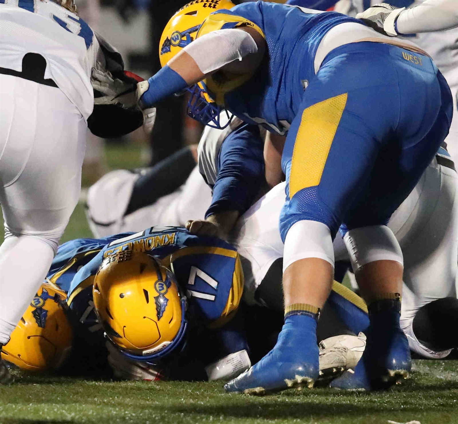 West Seneca's Nick Knowies recovers a fumble.