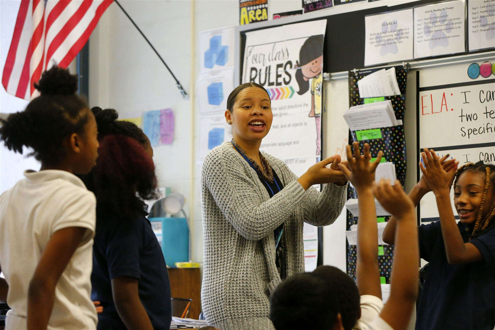 Fourth grade teacher Tiffany Bryant works with her students on a science lesson at BUILD Academy in Buffalo.