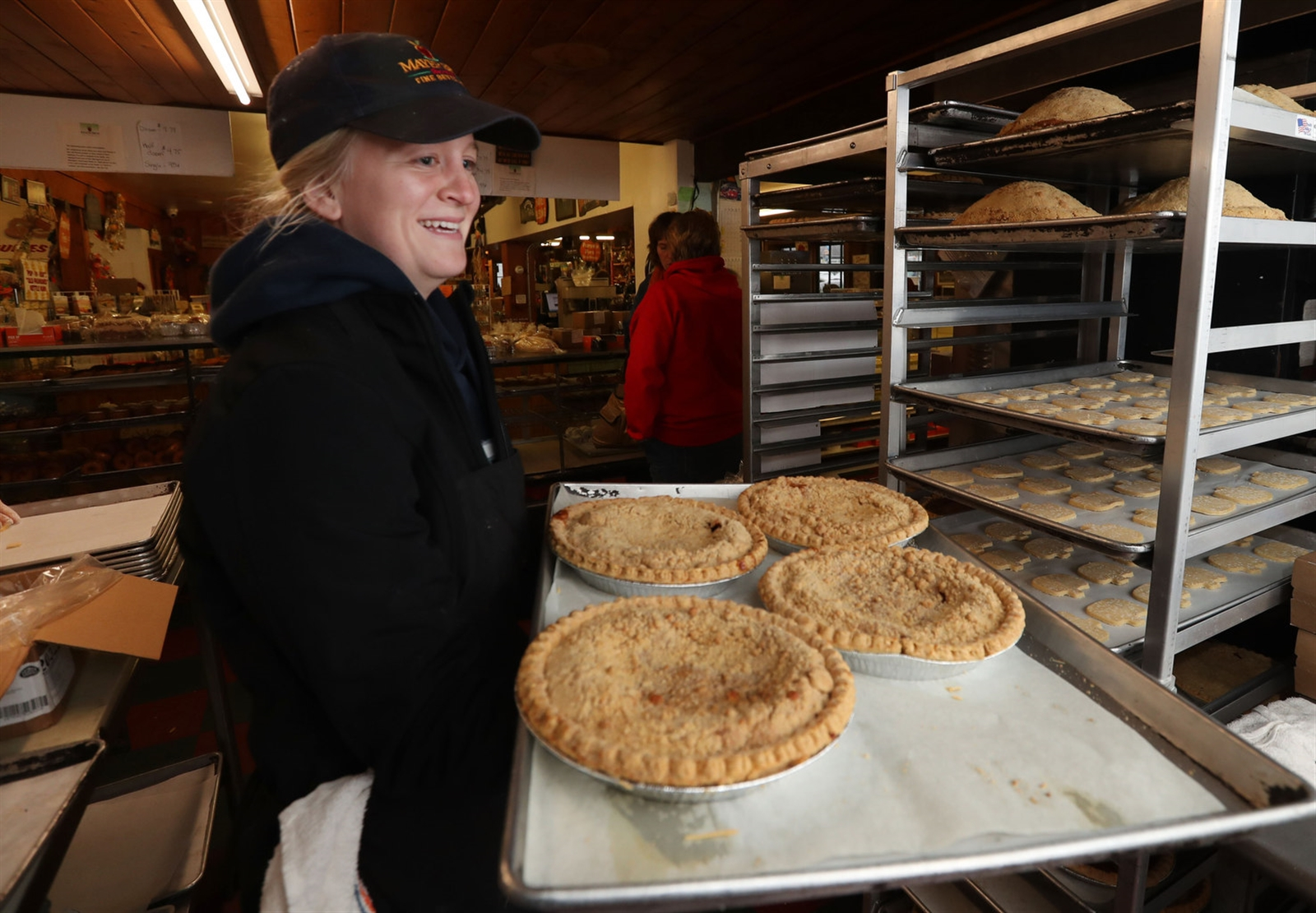 They make so many pies during Thanksgiving that Assistant Manager Amy Bednasz carries pies to an outside container to cool.