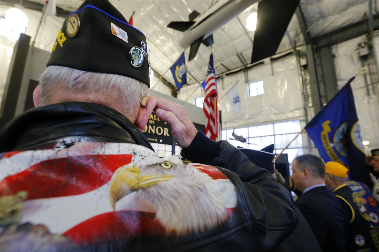 Veterans salute the Presentation of the Colors during a ceremony commemorating the 76th anniversary of the attack on Pearl Harbor, held Dec. 7 at the Buffalo & Erie County Naval & Military Park.