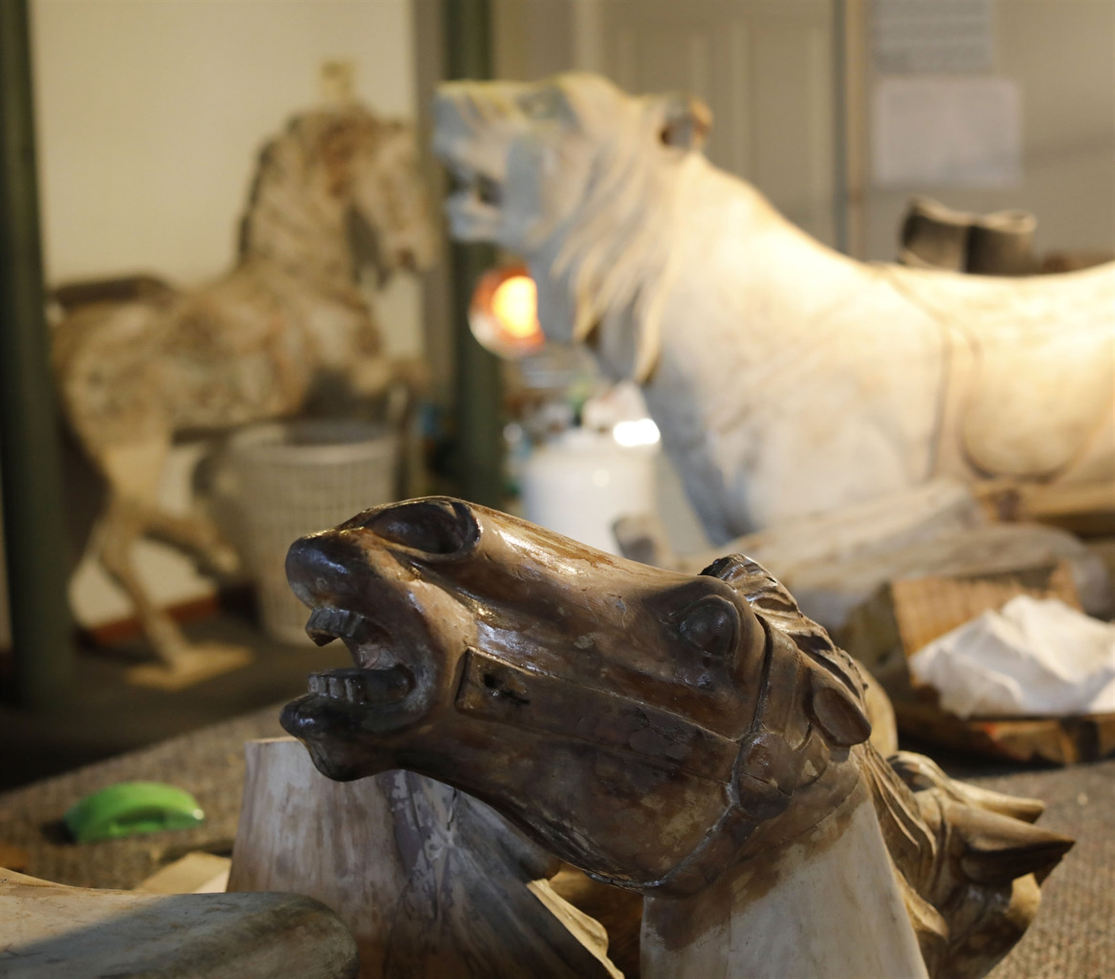 Pieces of horses are meticulously repaired in the carving shop.