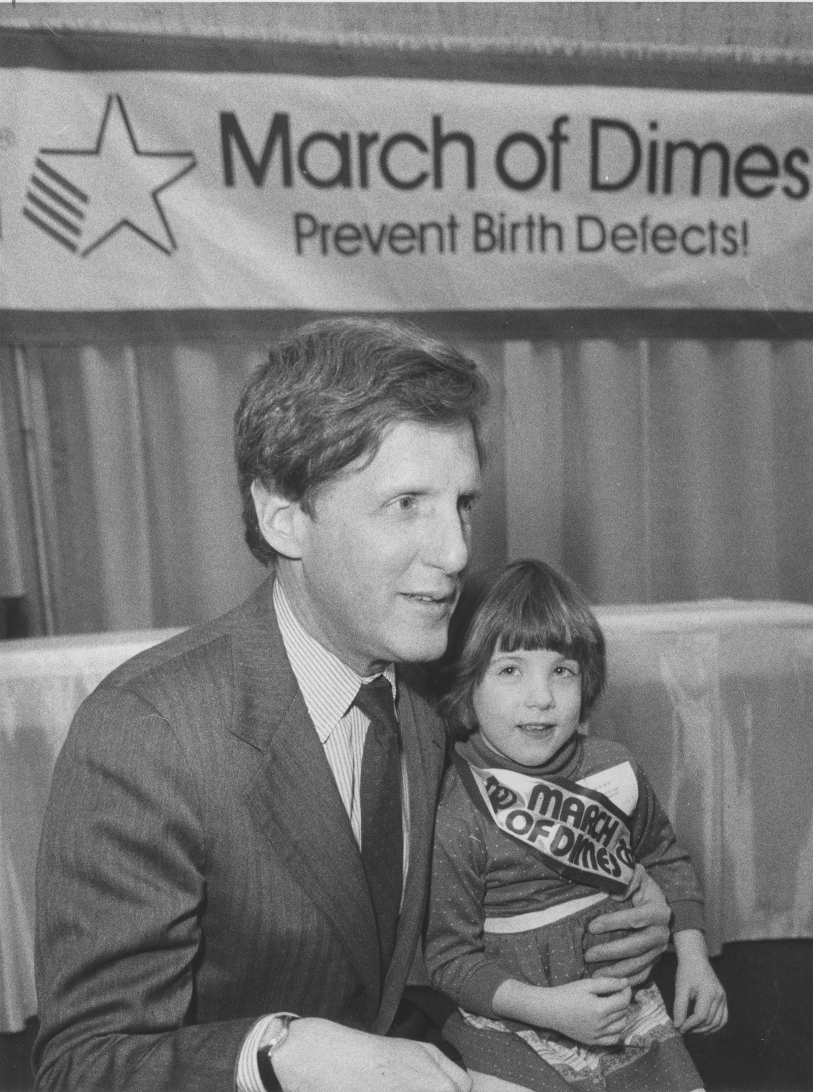Robert Wilmers, March of Dimes honorary TeamWalk chairman, and Sara McBride, 4, of Chaffee, the group's Western New York poster child, unveil plans to raise $250,000 during the local TeamWalk on Feb. 19, 1986.