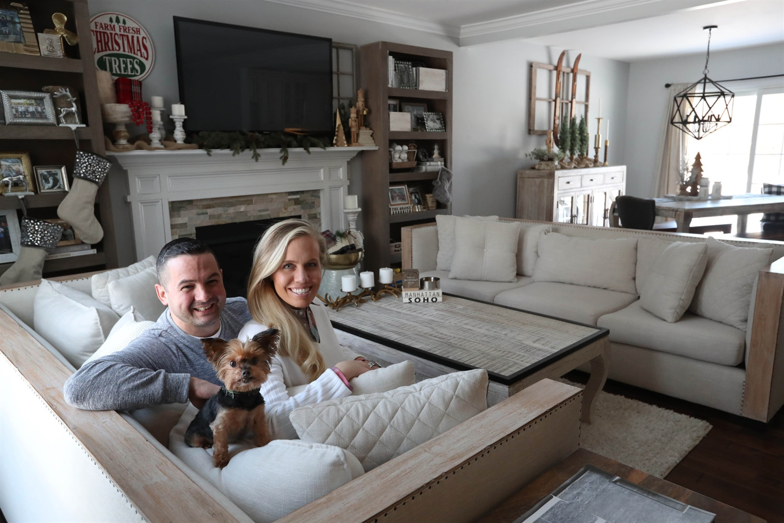 Adam and Heidie Buffomante, along with their Yorkie, Daisy, are ready for the holidays in their home located just outside the Village of Williamsville.