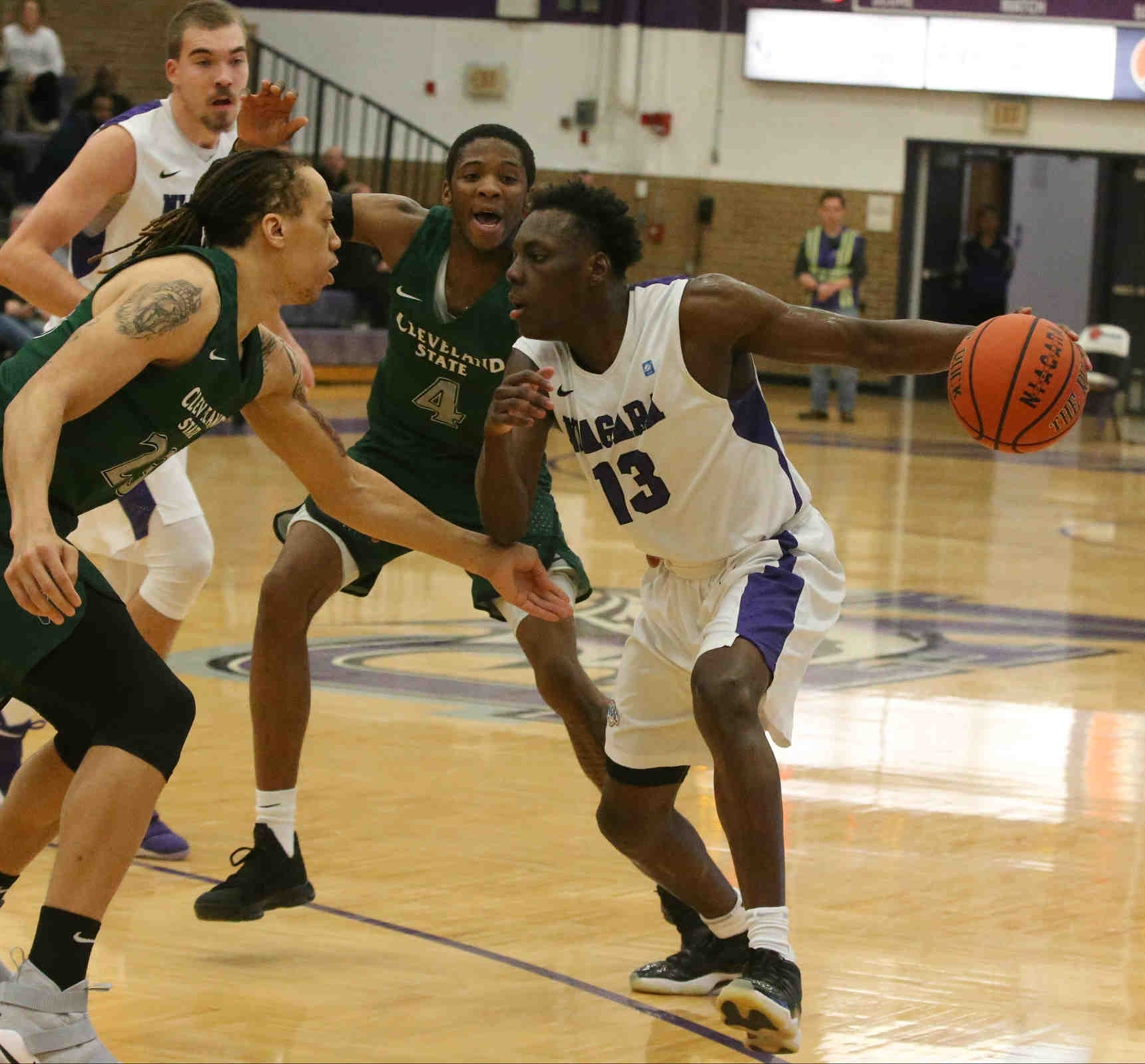 Niagara Purple Eagles guard Matt Scott (13) scores two points over Cleveland State Vikings forward Jamarcus Hairston (23) in the first half.