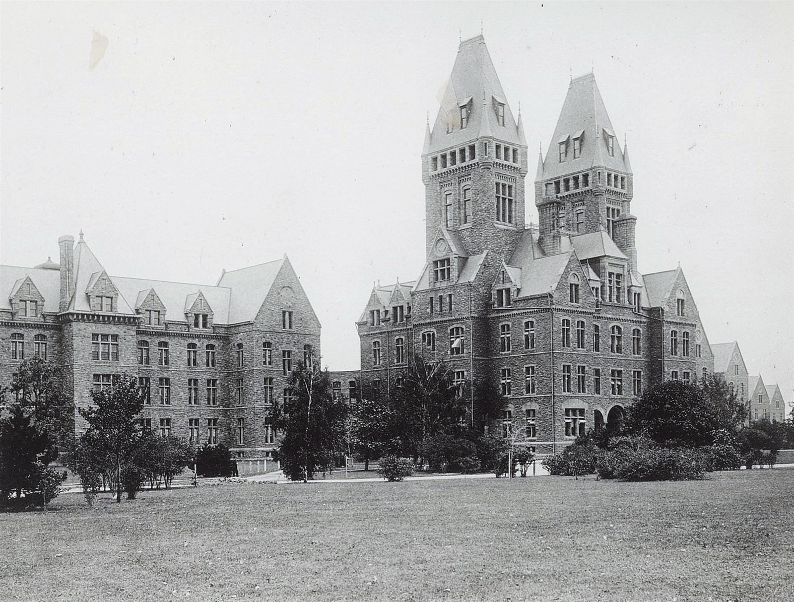 Then: The H.H. Richardson Complex, known as the Buffalo State Asylum when it opened in 1880, is one of Buffalo's most architecturally important structures. It was designed by architect Henry Hobson Richardson in the Richardsonian Romanesque style. Frederick Law Olmsted and Calvert Vaux designed the grounds. It was operated as a mental health treatment facility, but through the 20th century, its services were gradually reduced until patients were totally moved out in the 1970s. The complex was abandoned until reuse construction began in the 2000s.
