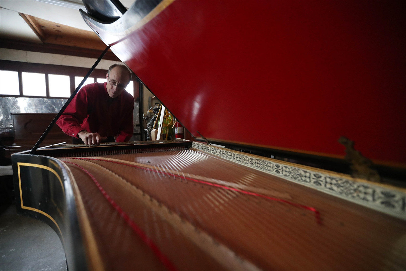 Bob Sowyrda, who rebuilt this harpsichord, tunes the instrument. Every time the Buffalo Chamber Players needed a harpsichord, they had to rent one, and purchasing one was too expensive.