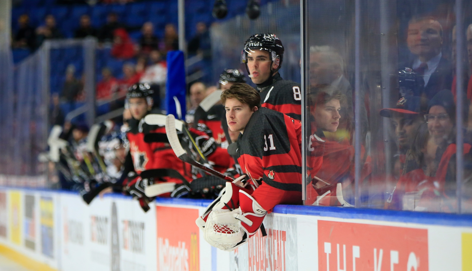 Team Canada goaltender Carter Hart watches from the bench against Slovakia.