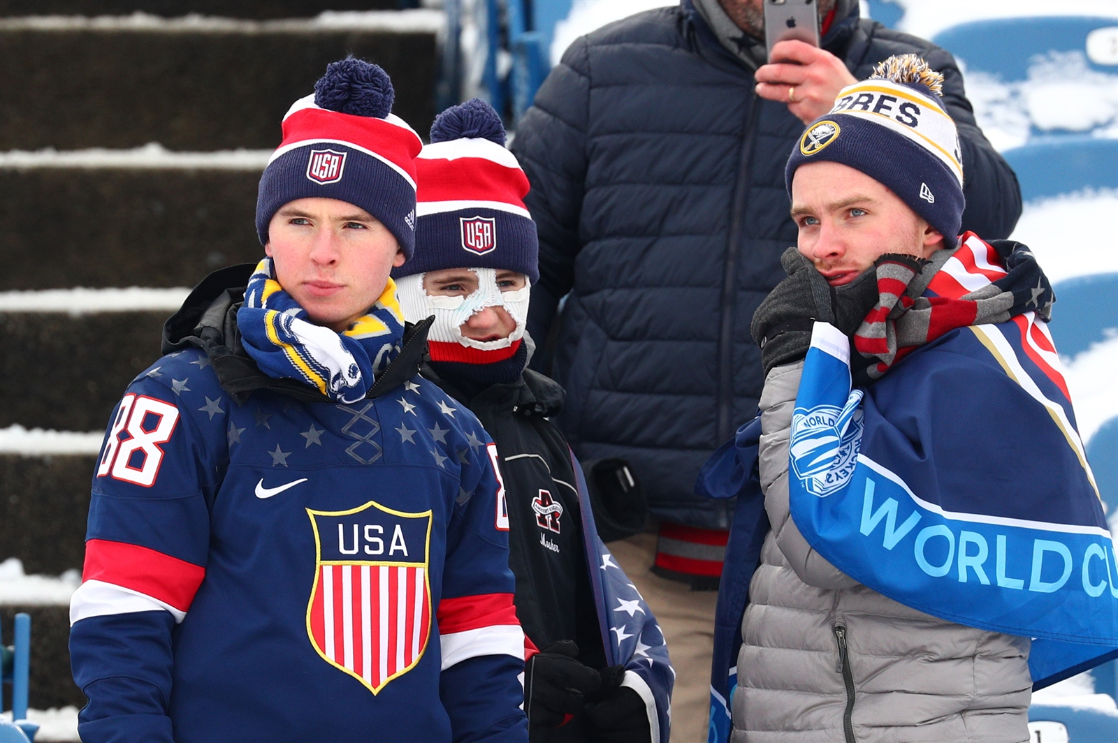 Fans show their support for their teams during the United States vs. Canada game at New Era Field in Orchard Park on Friday, Dec. 29, 2017.