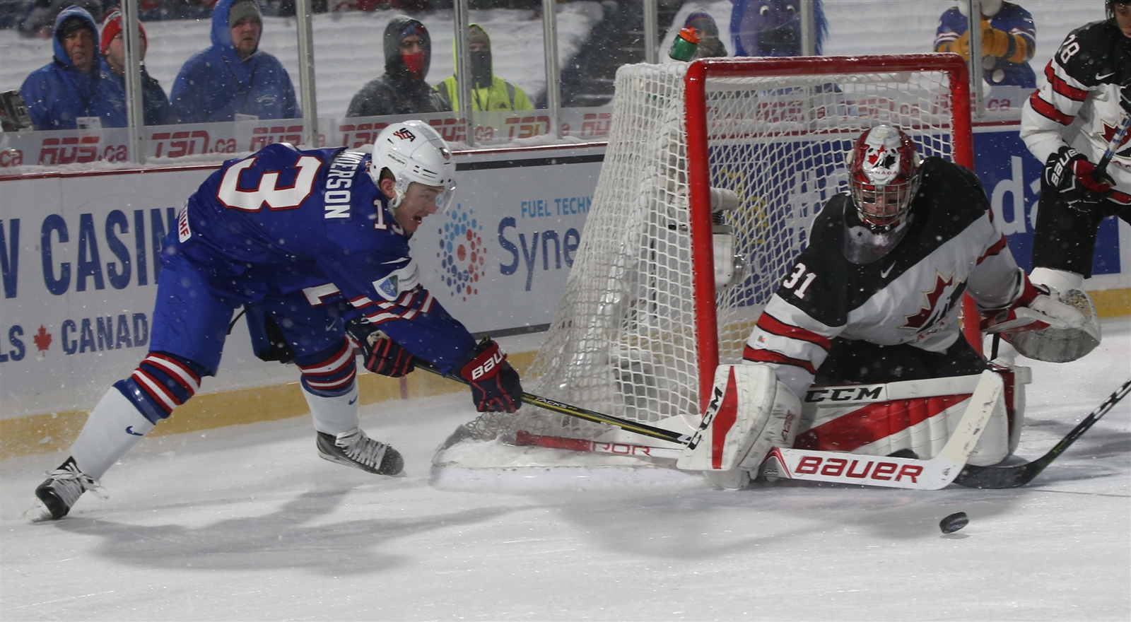 Brady Tkachuk #7 of United States scores a goal against Carter Hart #31 of Canada in overtime shootout  at New Era Field in Orchard Park on Friday, Dec. 29, 2017.