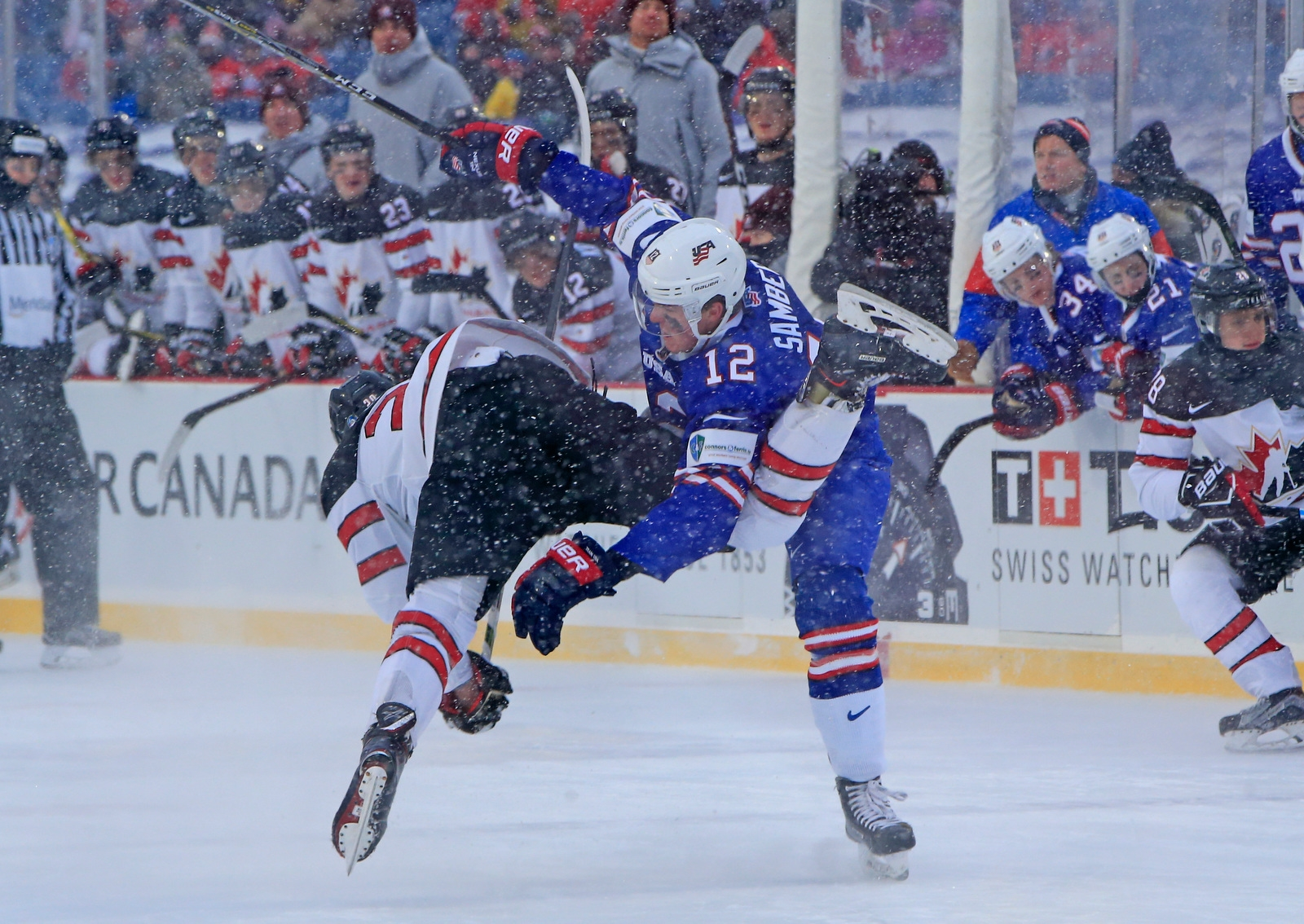 USA defenseman Dylan Samberg checks Canada's Michael McLeod during the first period.