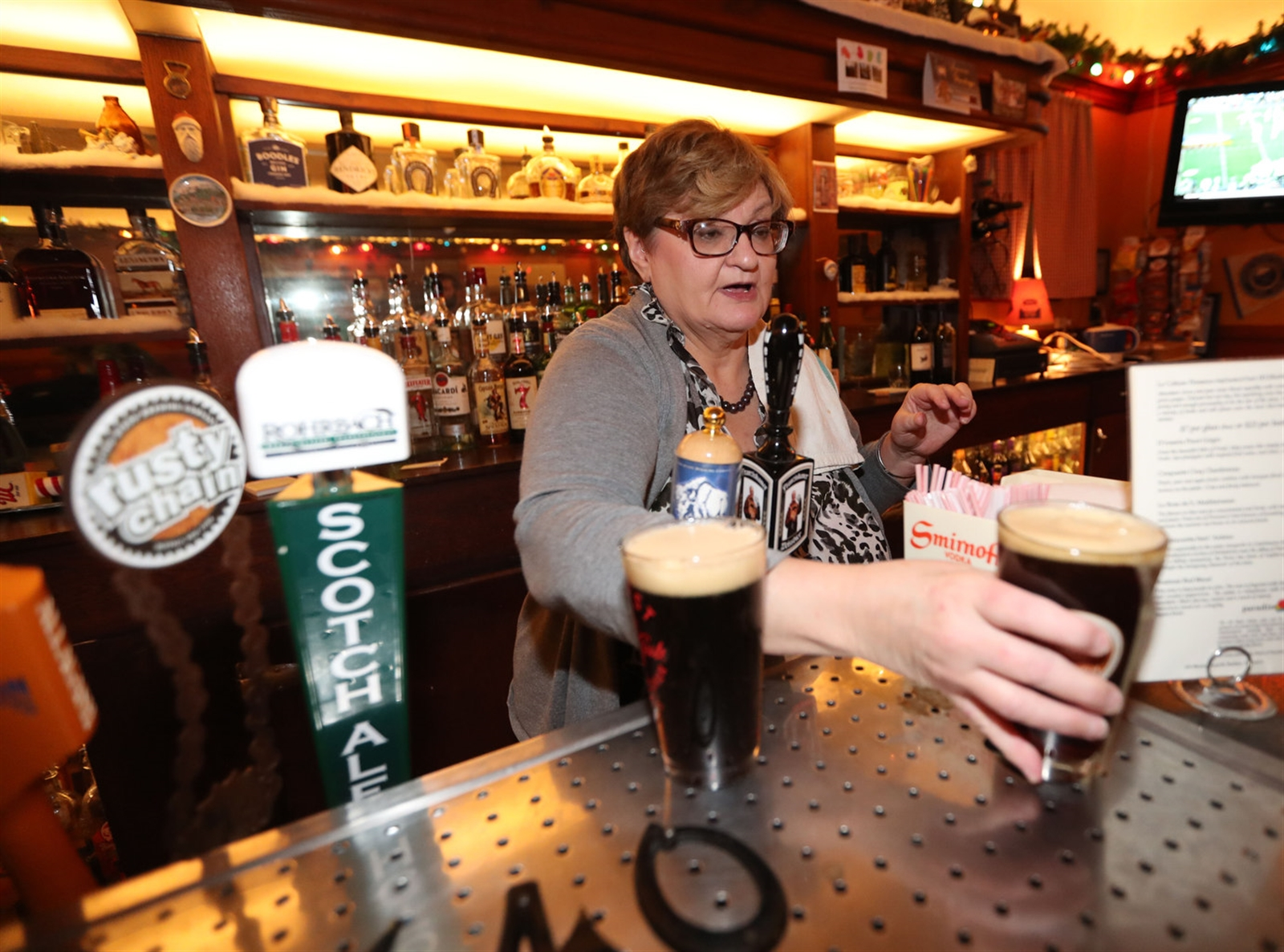 Bartender June Burrell pours a couple of Flying Bison Blizzard Bocks. Itu2019s a seasonal traditional German-style beer.