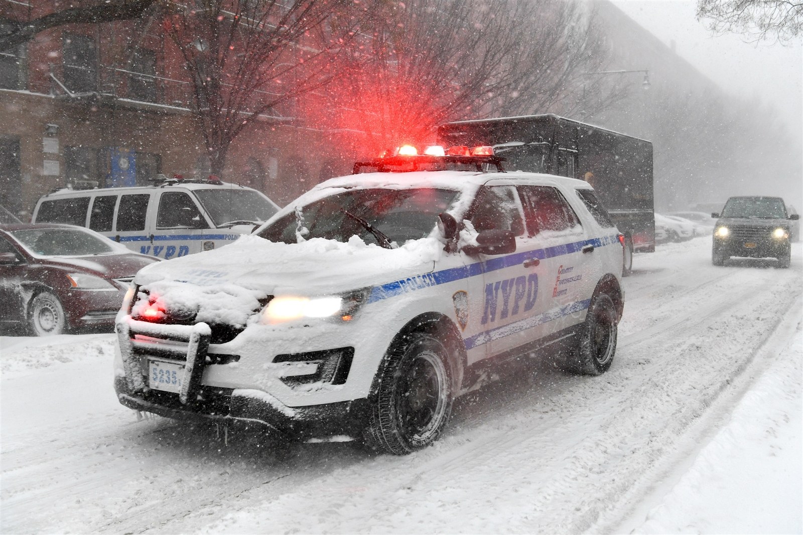 A New York Police Department vehicle drives through Harlem during a snow storm on January 4, 2018 in New York City. As a major winter storm moves up the Northeast corridor, New York City is under a winter storm warning and forecasts are calling for six to eight inches of snow.