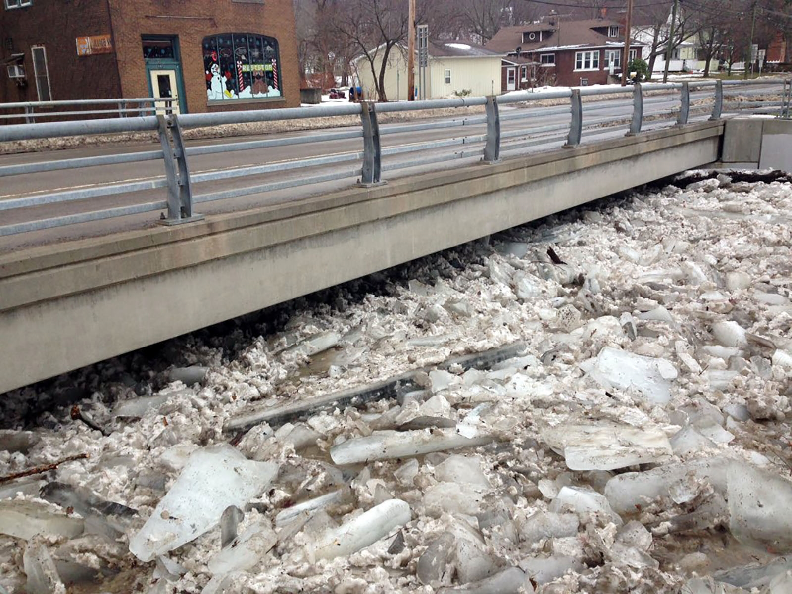 Large chunks of ice nearly scrape the underbelly of the Route 5 bridge in Silver Creek early Thursday.