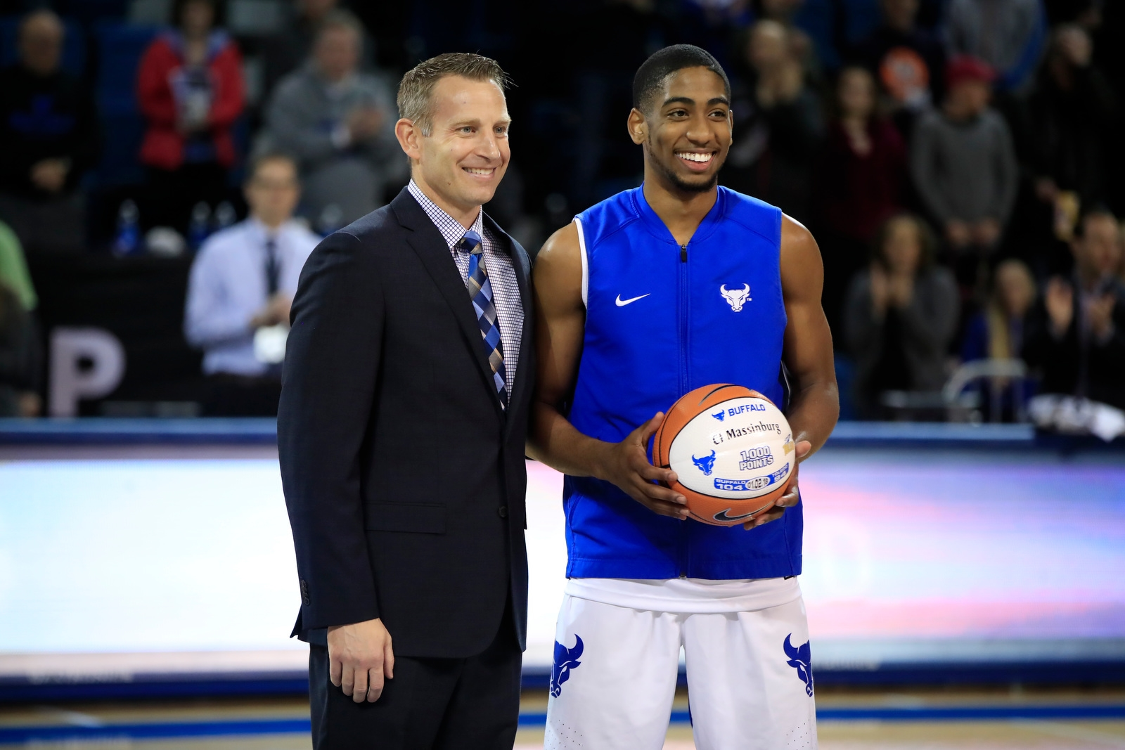 University at Buffalo head coach Nate Oats presents CJ Massinburg a ball commemorating his 1,000th point prior to playing Miami at Alumni Arena on Saturday, Jan. 13, 2018.