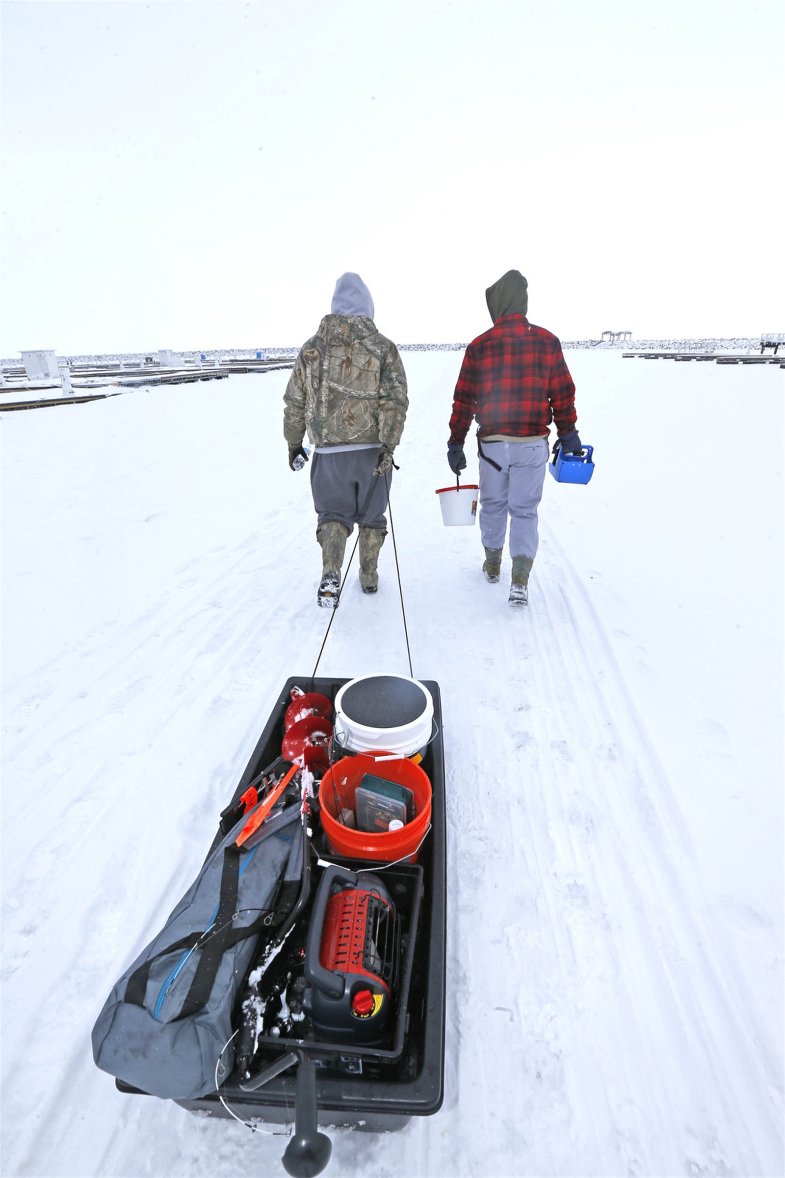 Two men, who wished to not give their names, make their trek out onto Lake Erie ice.