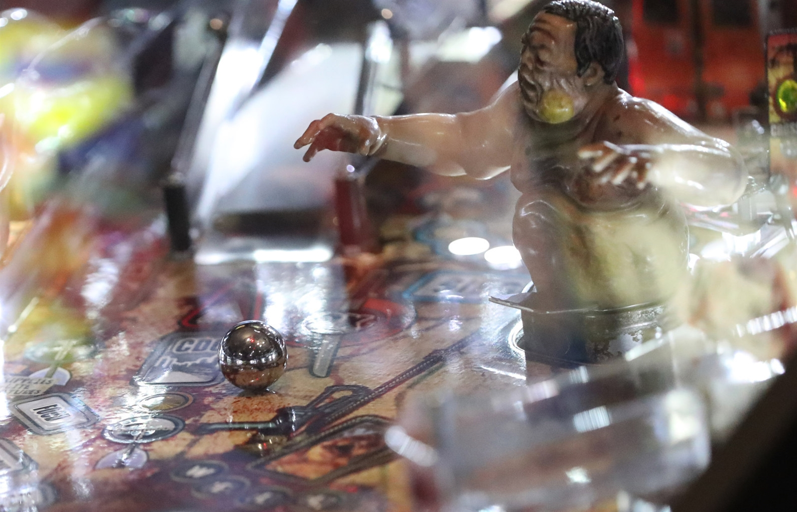 The pinball is the star of the show. This is a game of The Walking Dead being played.