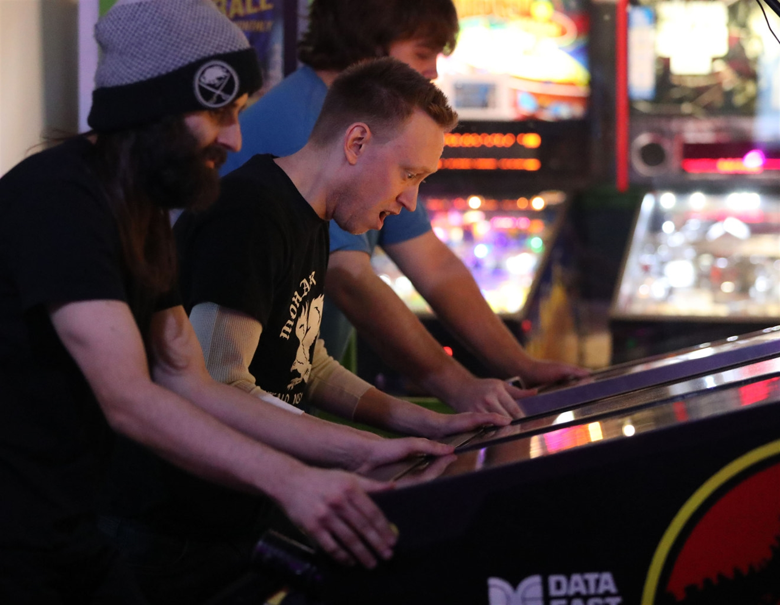 Nick Lane, center, one of the two locals competing, is very expressive as he plays.  He's the President of Buffalo Pinball and is also the tournament director.  On left is Grand Island native C.J. Smith of Brooklyn and Zachary Frey, of Rochester.