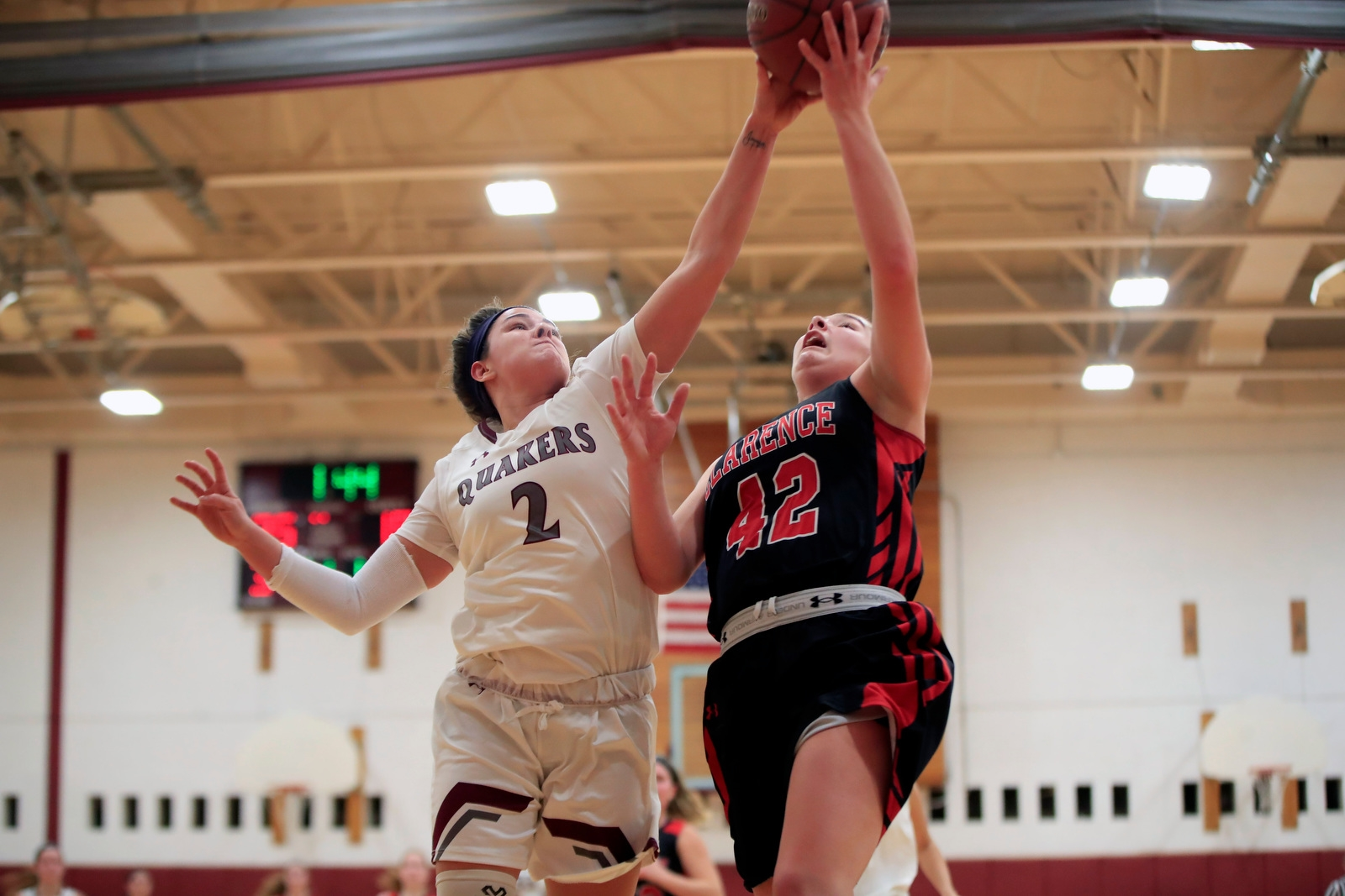 Clarence forward Theresa Bienko has her shot blocked by Orchard Park's Danielle Hore  during first half action at Orchard Park High School on Thursday, Jan. 25, 2018.