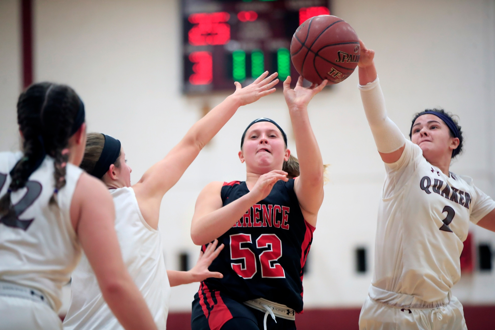 Clarence forward Maddy Stearns has her shot blocked by Orchard Park's Danielle Hore.