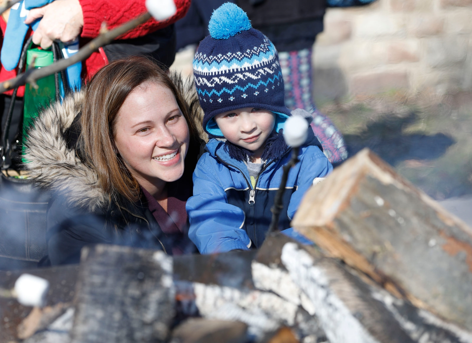 Danielle Haslinger and her son Will, 3, of Orchard Park roast marshmallows by the fire.