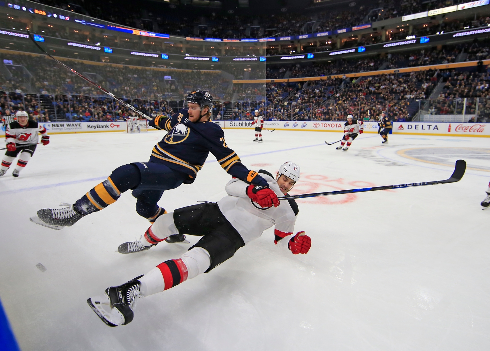 Buffalo Sabre Scott Wilson and New Jersey Devil Brian Boyle collide during first period action at the KeyBank Center on Tuesday, Jan. 30, 2018.