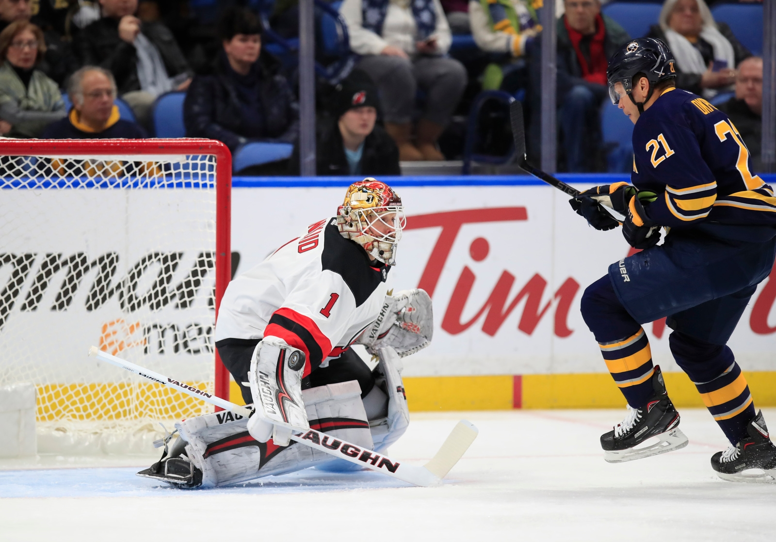 Buffalo Sabres Kyle Okposo is stopped by New Jersey Devils goaltender Keith Kinkaid during first period action at the KeyBank Center on Tuesday, Jan. 30, 2018.
