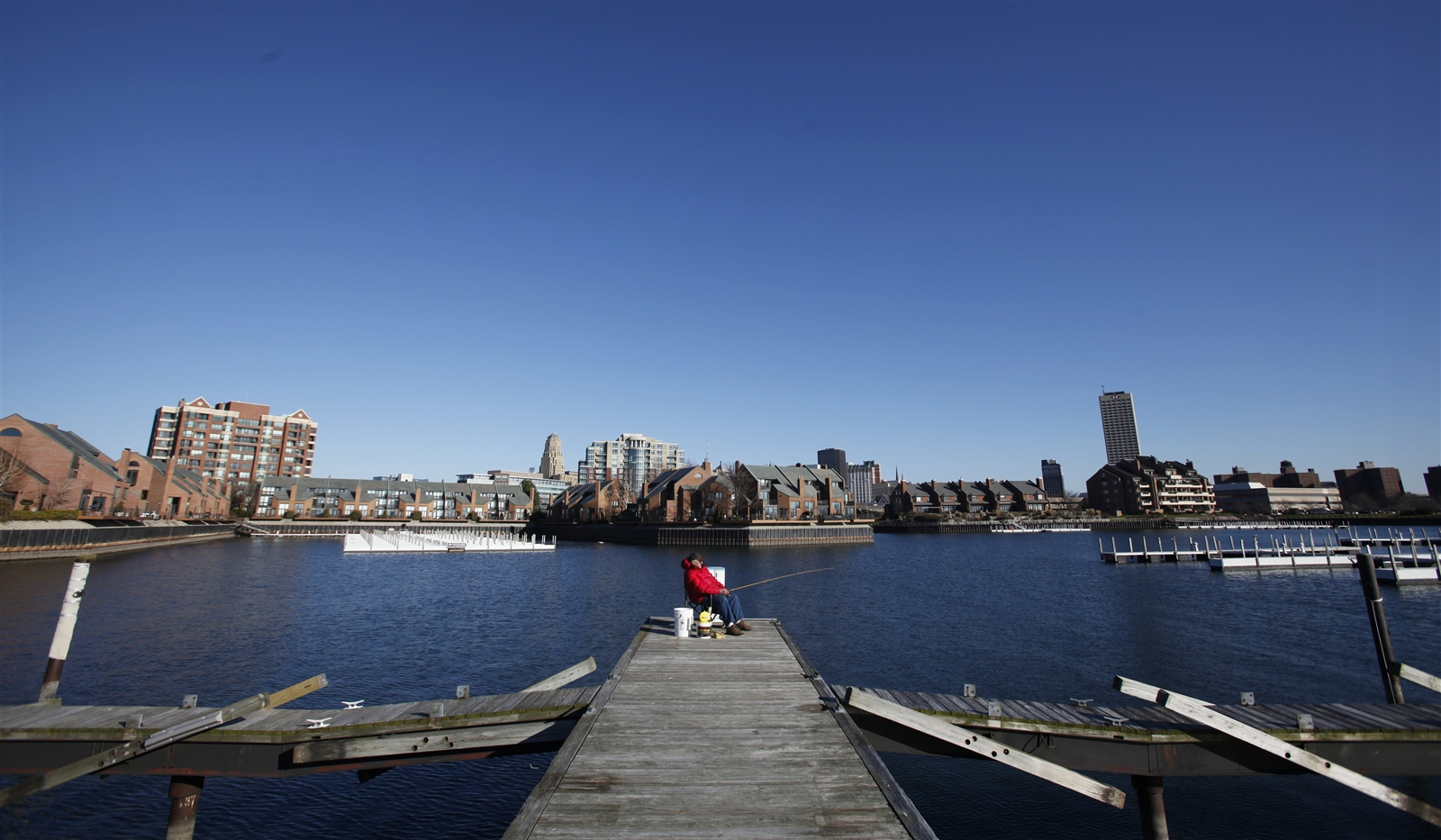 A man goes fishing for perch  along the docks of the Erie Basin  Marina on Dec. 13, 2012.