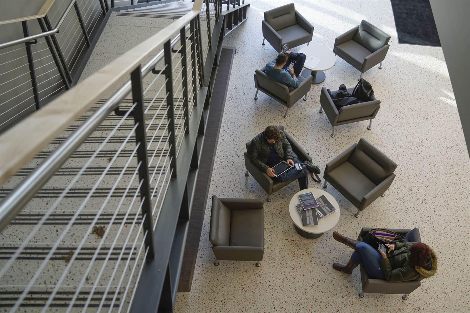 Students sit in a lounge area in the lobby of the new STEM Building at ECC North Campus.