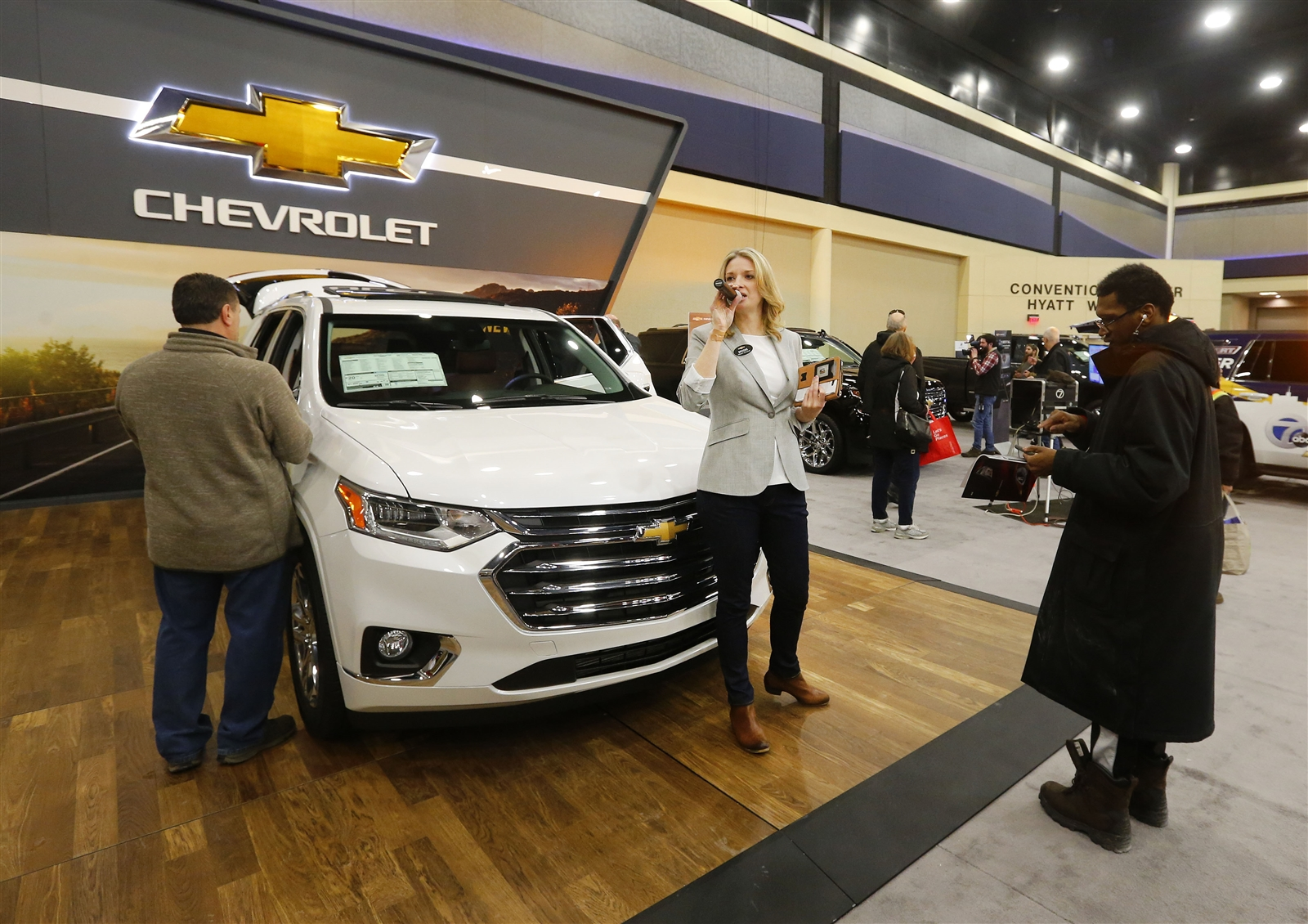 Product Specialist Brooke Evans talks about the Chevrolet cars on the floor at the Buffalo Auto Show at the Convention Center in Buffalo Thursday, February 8, 2018.