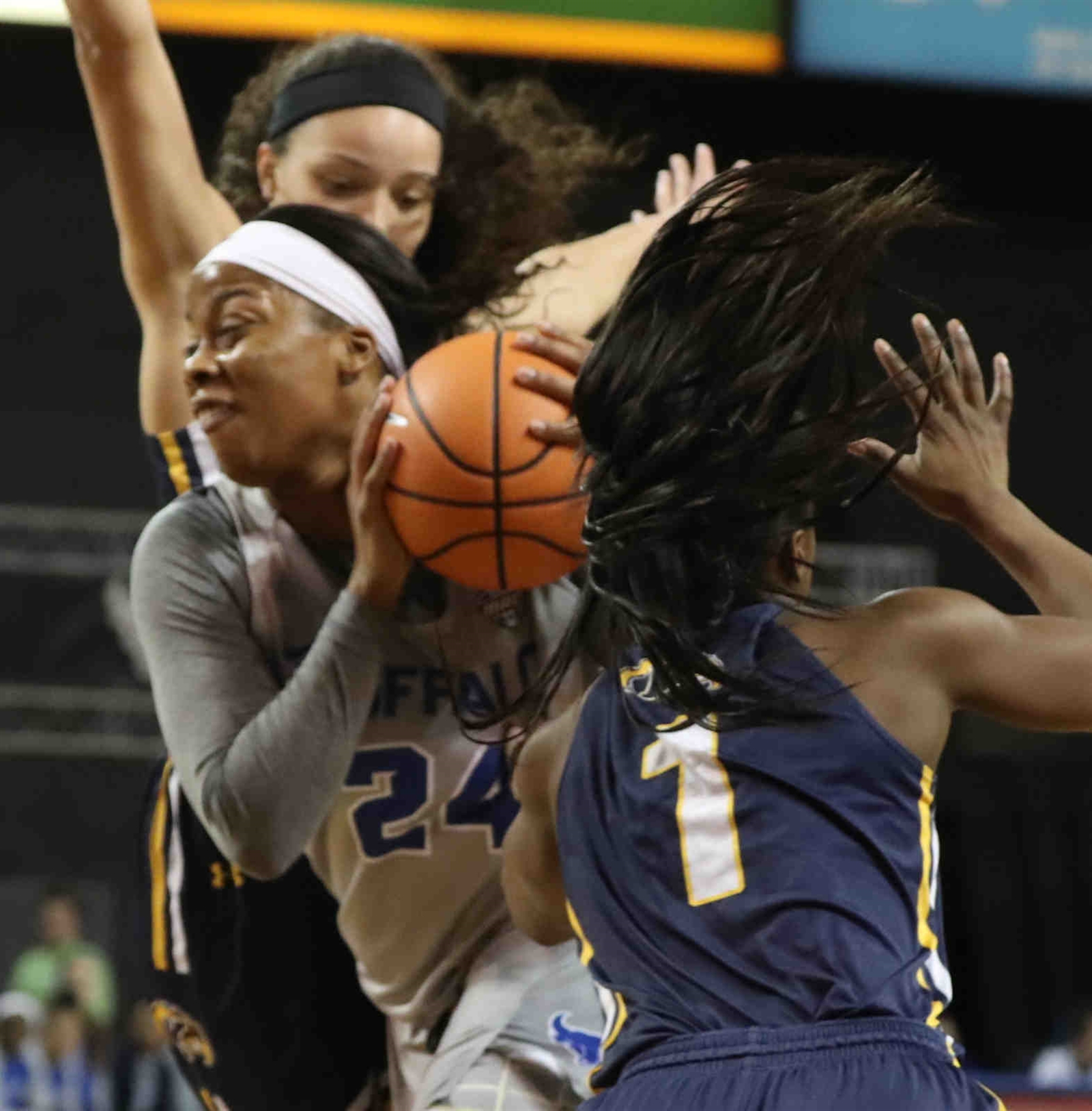 Buffalo Bulls guard Cierra Dillard (24) scores two points over Kent State Golden Flashes guard Naddiyah Cross (1) in the first half.