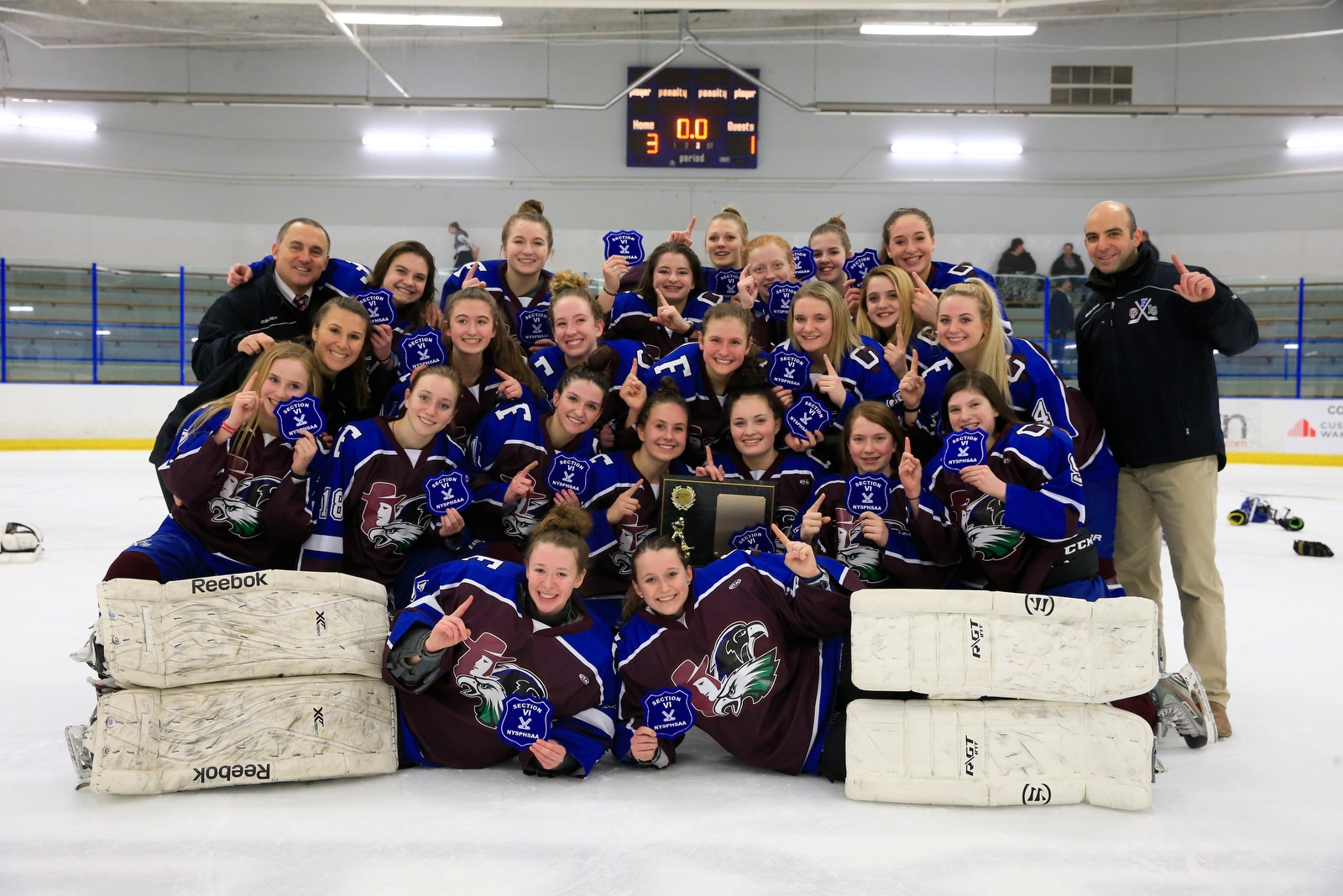 Frontier/Lakeshore/Orchard Park celebrates a 3-1 victory over Williamsville for the Section VI Girls hockey championship at the Northtown Center on Wednesday, Feb. 7, 2018.
