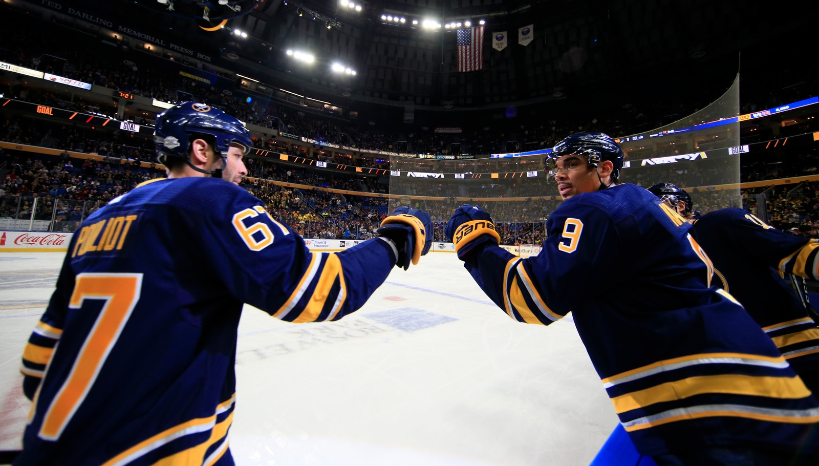 Buffalo Sabres' Evander Kane congratulates Benoit Pouliot on his shorthanded goal against the Colorado Avalanche during first period action at KeyBank Center on Sunday, Feb. 11, 2018.