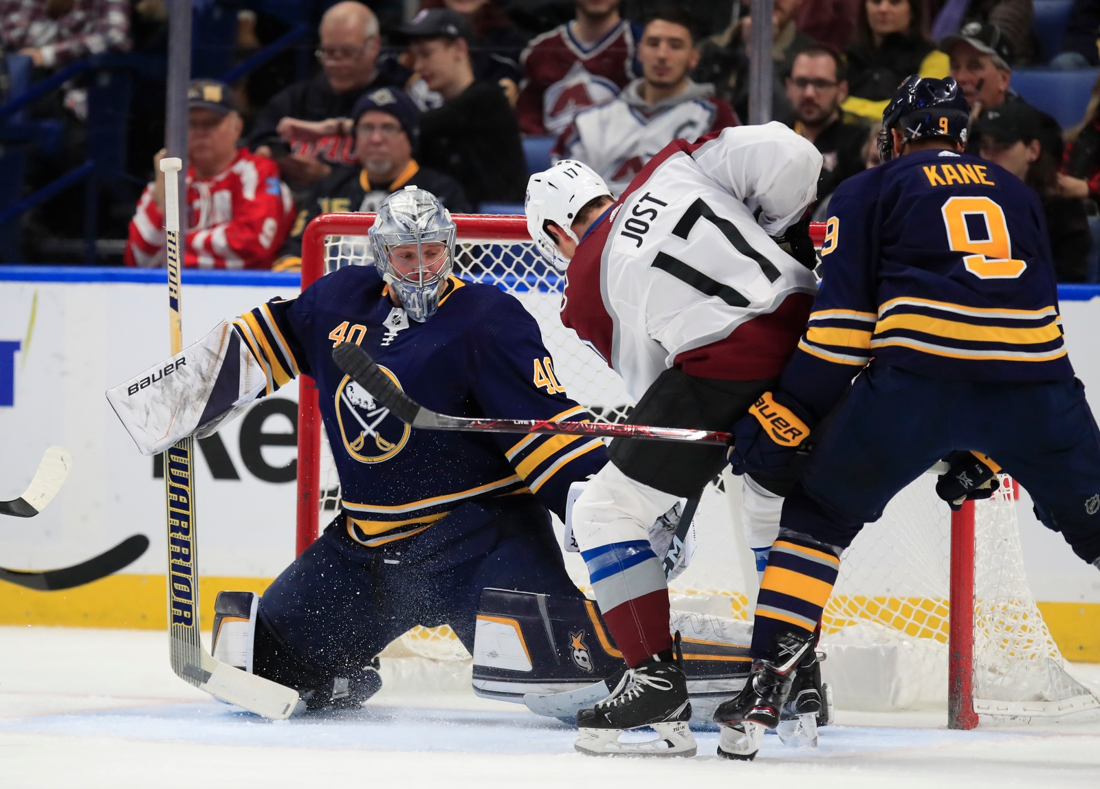 Buffalo Sabres goaltender Robin Lehner makes a save on Colorado Avalanche's Tyson Jost during first period action.