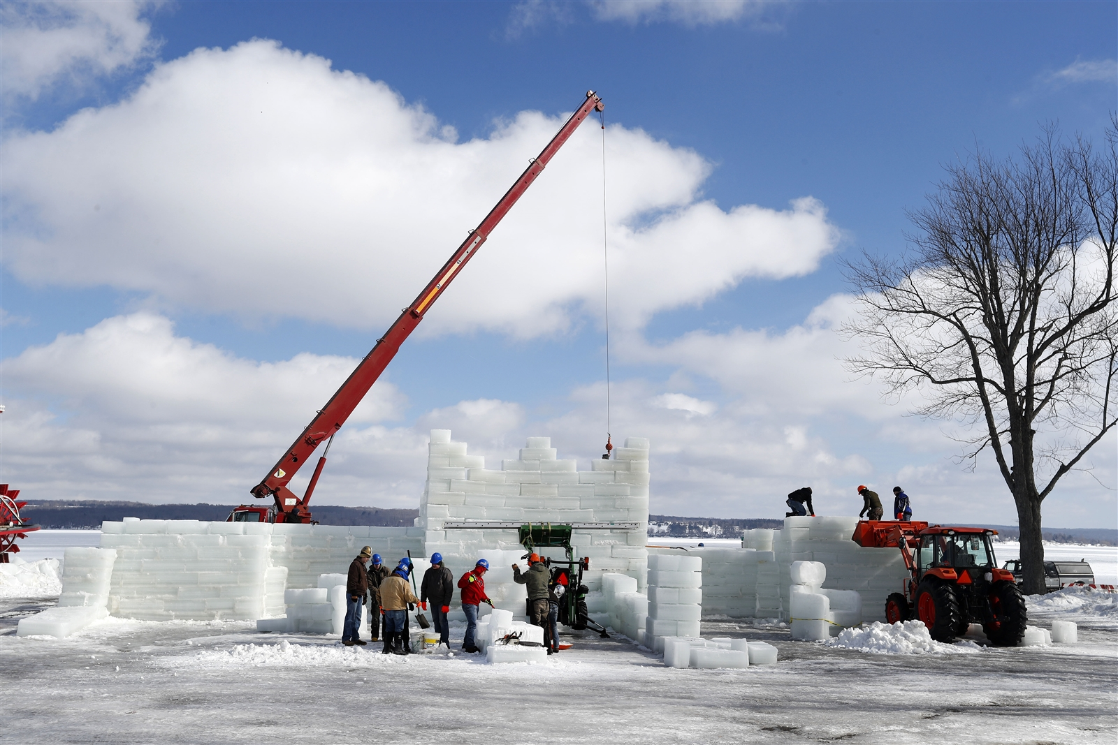 Crews move ice blocks into place as they build the Ice Castle in Mayville on Monday, Feb. 12, 2018.