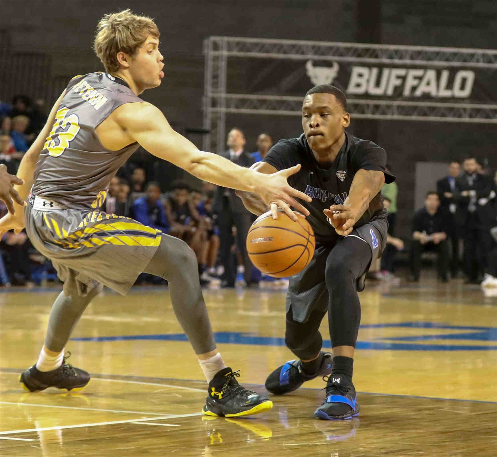 Buffalo Bulls guard Davonta Jordan (4) passes the ball past Kent State Golden Flashes guard Mitch Peterson (13) in the first half.